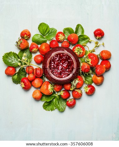 Strawberries  jam-jar and fresh berries plant from garden. Strawberries preserving. Top view - stock photo