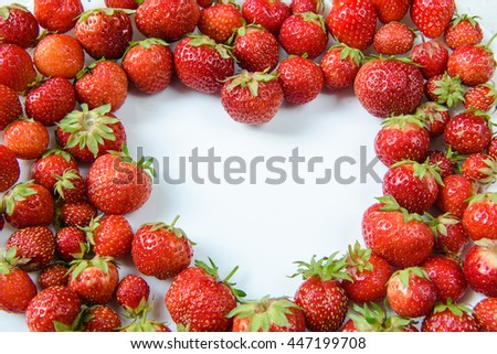 strawberries laid out on a plate in the form of heart