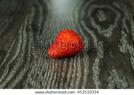strawberries on a brown background