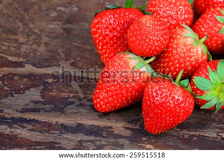 strawberries on the wooden background - stock photo