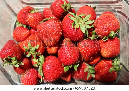 Strawberries - Ripe, Red Strawberries in a Carton on Table - Summer background