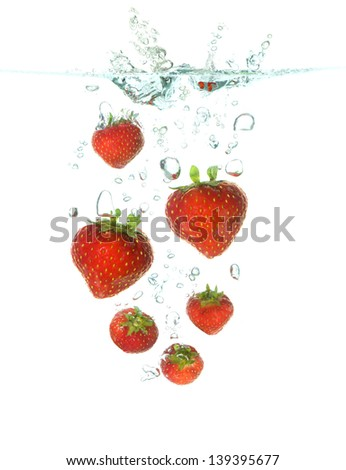 strawberries splash in clear water isolated on white