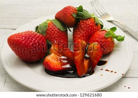 strawberries with balsamic vinegar - stock photo