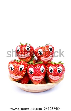 Strawberries with eyes and mouth isolated on white background - stock photo