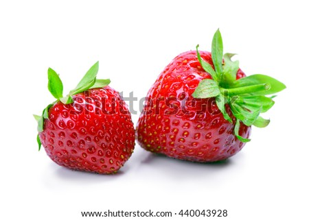 Strawberries with leaves isolated on a white background - stock photo
