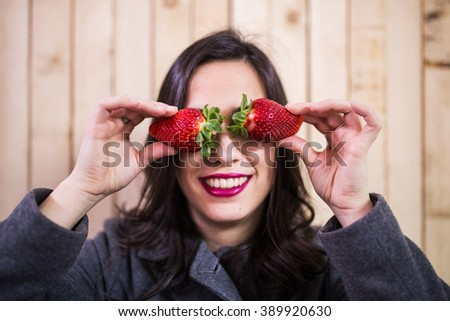 strawberries young woman with eyes - stock photo