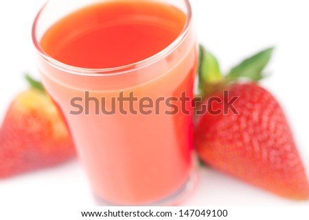 strawberry and a glass of strawberry juice isolated on white