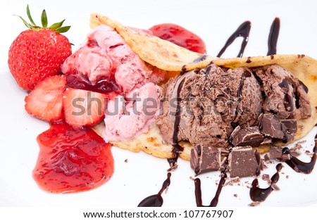 Strawberry- and Chocolate Ice Cream topped with Caramel Syrup isolated on white background