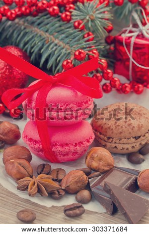strawberry and chocolate macaroons  with christmas tree and decorations close up