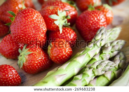 Strawberry and Green asparagus - stock photo
