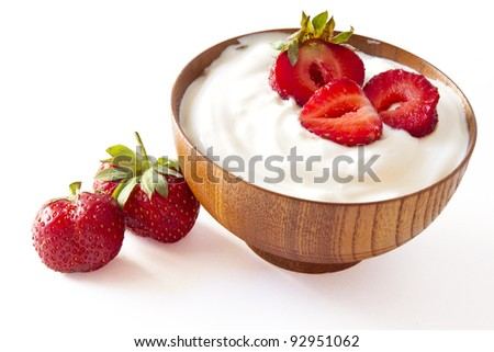strawberry and yogurt  in a wooden bowl on withe background