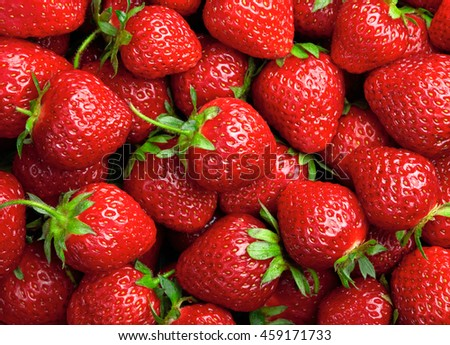 Strawberry background. Red ripe organic strawberries on market counter