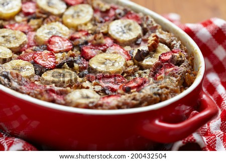 Strawberry Banana Oatmeal with chocolate and pecan nuts - stock photo