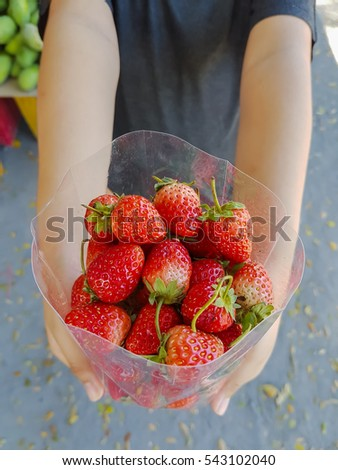 Strawberry berries in a plastic bag.