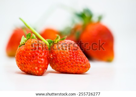 Strawberry berries on a white background.