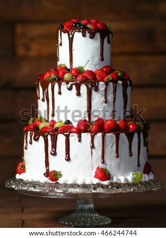 Strawberry cake on a wooden background.