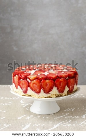 Strawberry cake on cake stand, copy space - stock photo