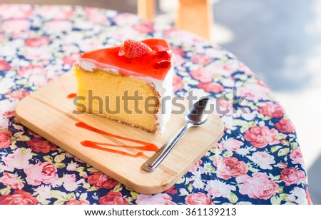 Strawberry Cake on wooden plate.