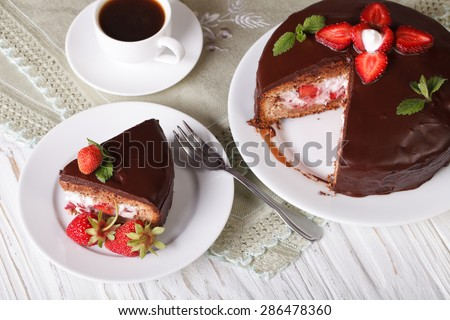 strawberry cake with chocolate and coffee on the table. horizontal view from above