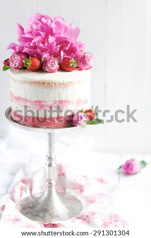 Strawberry cake with floral decoration on a white background