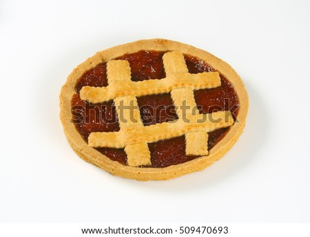 strawberry cake with lattice on top on white background