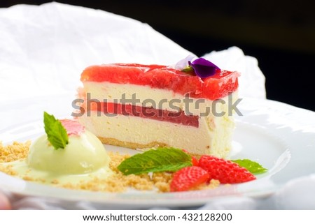 Strawberry cheese cake with mint ice cream - stock photo