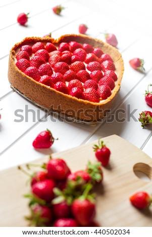 strawberry cheesecake on white background, selective focus - stock photo