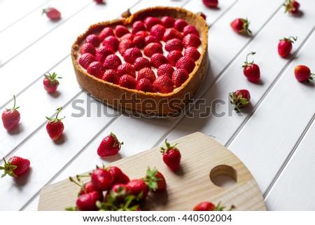Strawberry cheesecake on white wood - stock photo