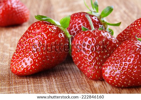 Strawberry close-up on chopping board - stock photo