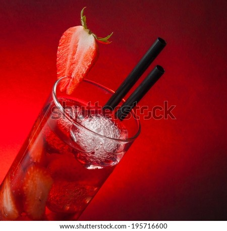 Strawberry cocktail with ice with space for text and a red gradient background - stock photo