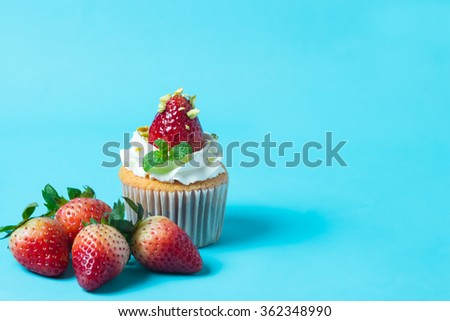 strawberry cupcak topping with pistachio and cream,selective focus - stock photo