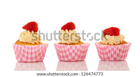 Strawberry cupcakes with buttercream isolated over white background