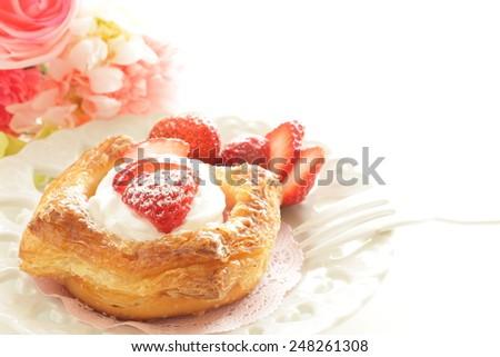 strawberry danish pastry  - stock photo