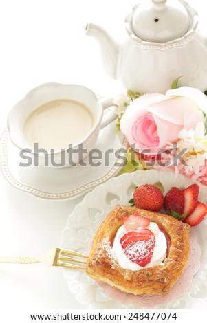 strawberry danish pastry and milk tea - stock photo