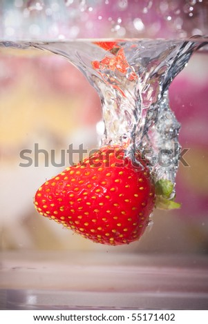 Strawberry Dropped Into Water - stock photo