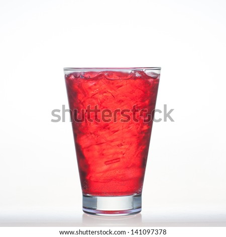 Strawberry flavor aerated drinks whit soda and ice in glass isolated on white background