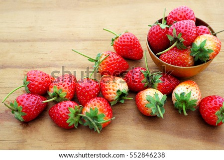 Strawberry fresh berries on a wood background.