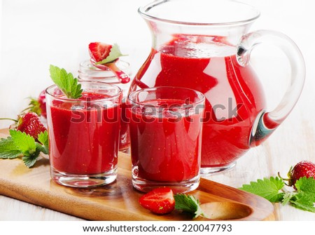 Strawberry fresh smoothie with  berries on  a wooden background . Selective focus