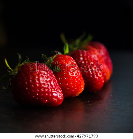 Strawberry, fresh strawberry, ripe strawberry, healthy strawberry,  strawberry on black background - stock photo