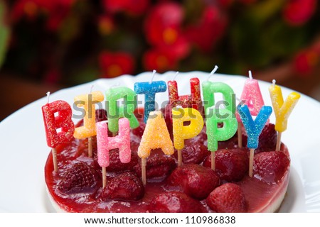 Strawberry Happy birthday cake - stock photo