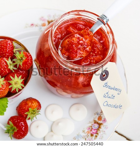 Strawberry homemade jam in jar with white chocolate. healthy organic and vegan food. - stock photo