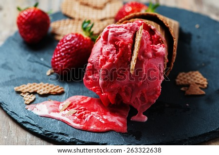 Strawberry icecream on the wooden table, selective focus - stock photo
