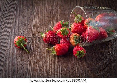 Strawberry in a Bowl on wooden table - stock photo