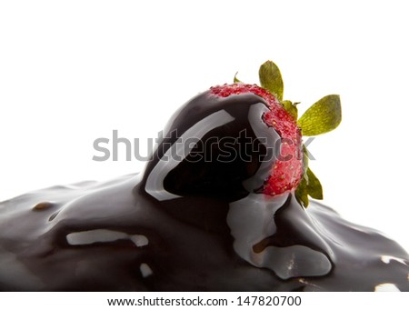 strawberry in a chocolate on a white background