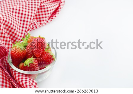 strawberry in bowl with red napkin isolated on white background