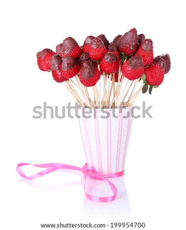 Strawberry in chocolate on skewers in cup isolated on white - stock photo
