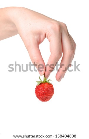 Strawberry in  hand  isolated on white background