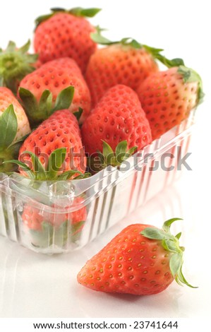 strawberry in packaging with a special one out of the box - stock photo