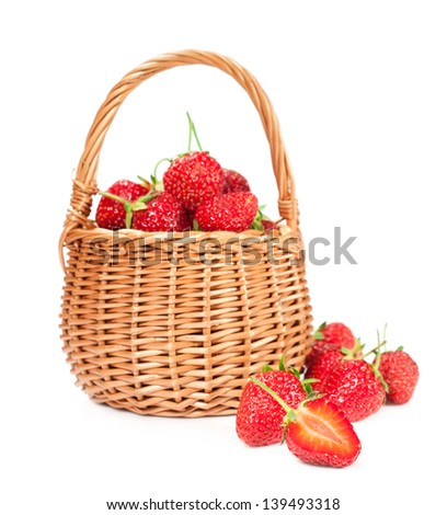 strawberry in wicker basket isolated on a white background