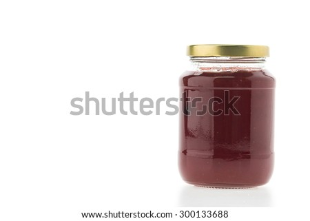 Strawberry jam jar isolated on white background